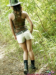 Tiny petite babe Tussinee in camo gear strips outside