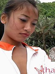 Tiny Thai ecumenical walks around a private beach and sucks cock