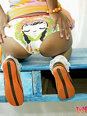 Cute petite Thai model in pigtails shows off her tiny assets