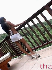 Thainee posing like a movie star on a balcony in Thailand