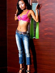 Petite Thai teen slowly takes off her pink bra and blue jeans