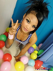 Super pretty Thai babe Tussinee in her playroom stripping