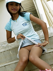 Thai cutie upskirt action outdoors and she has no huff and puff