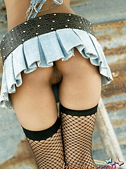 Cutie shows some upskirt action with no panties before stripping