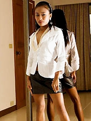 Tiny pornstar strips from white and black office outfit in front of a mirror