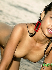 Cute Tussinee posing naked on the beach added to takes a skinny dip