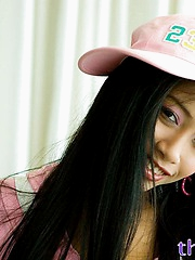 Ephemeral hot Thai girl Thainee in a sexy pink zippered hoodie shows tits