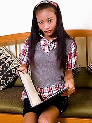 Schoolgirl Thainee is horny after a long day and strips to show her tight body
