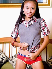 Schoolgirl Thainee is lickerish after a long phase and strips to show will not hear of niggardly body