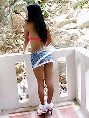 Thainee poses in a balcony wearing a sexy outfit