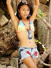 Thai bikini teen prances around a private beach in Thailand