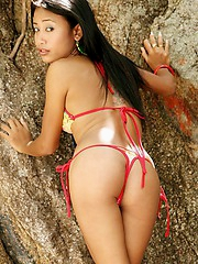 Thai bikini teen prances around a private beach in Thailand