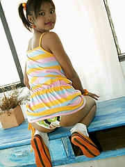 Tiny pigtail beauty Tussinee is in pigtails and teases us with her tight ass