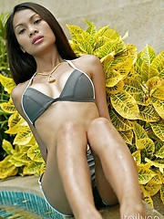 Thai adult model Tailynn Posing Sensually by the Pool