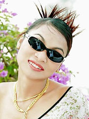 Glamour Thai partition Tailynn poses outdoors