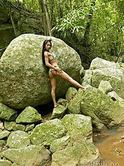 Hot Asian Tailynn nearly a skimpy bikini and hard nipples posing apart from the waterfall