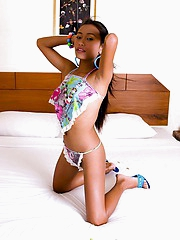 Sexy Thai pet Thainee strips out of their way little top with an increment of thong