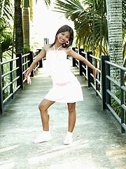 Crestfallen Thai teenaged flashes outside at the gardens