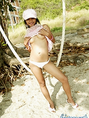 Asian teen reveals her perky boobs while playing on the swing