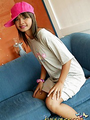Thai cutie posing innocently in a baseball hat and tee shirt