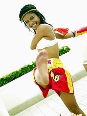 Cute Thai model having fun posing in boxing outfit