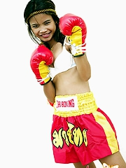 Cute Thai model having fun posing in boxing outfit