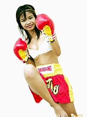 Cute Thai engrave having fun posing in boxing outfit