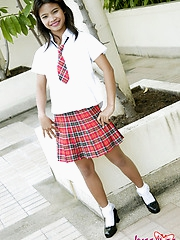 Schoolgirl Tussinee in an after school photo shoot