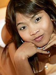 Innocent Asian nubile in cute underwear plays in bed