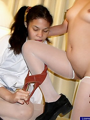 College girl toying the tight pussy of her classmate with a big dildo