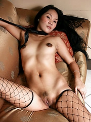 Carla in fishnet tights spreads her legs to flash her brown love orifices