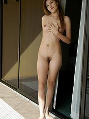 University pupil posing nude on chum around with annoy balcony of a love caravanserai