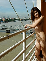 University student posing nude on the balcony of a love hotel