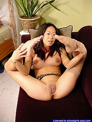 Asian girl in stockings spreading wide to flash her inviting opened vagina
