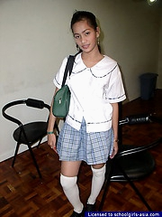 Busty schoolgirl spreading her pussy lips to show some pink