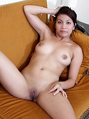 Young Chady strips and spreads wide to flash her brown love orifices