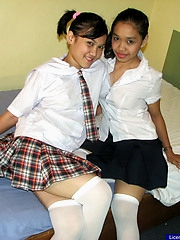 Two cute order of the day students are occupied in a passionate mutual pussy grinding session