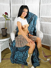 Leanna strips from her school uniform to pleasure her shaved pink pussy with a sextoy