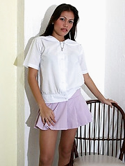 Larina slowly removes her school uniform to unveil her private treasures