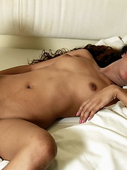 Juna takes off her red nightie and spreads to show her brown pussy