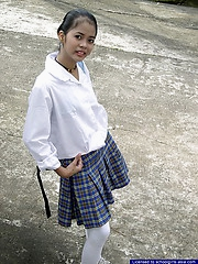 Slim young chick stripping of her school uniform to flash her neat vagina