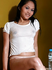 Cute and hot doll wetting will not hear of t-shirt and spreading will not hear of pussy lips