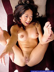 Busty petite coed toying her tight hairless slit close by a dildo