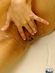 Sasha playing in the bathtub