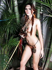 Thai Riyo posing nude in the jungle