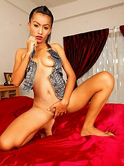 Thai Jun spreading her pussylips