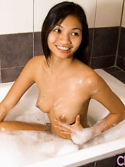 Thai babe Nid soaping up