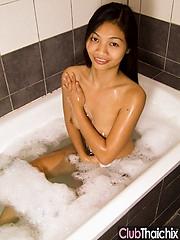 Thai babe Nid soaping up