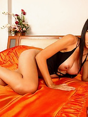 Thai girl Mintra spreading pussy
