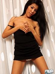 Tatooed Thai girl Natty smoking